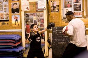 Gallery All Stars Boxing Gym: Junior Coach Tyrone Forbes with a young boxer