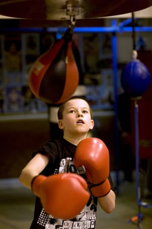 Gallery All Stars Boxing Gym: Young boxer training with a punchbag