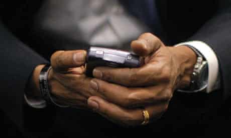 Barack Obama holds his BlackBerry