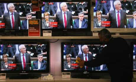 Televisions showing Alistair Darling as he delivers his Pre-Budget Report