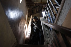 Gallery Mumbai terror attacks: Indian commando  looks at an apartment where gunmen hold hostages in Mumbai