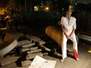 Gallery Mumbai terror attacks: An unidentified survivor sits outside the Taj Mahal Hotel mumbai