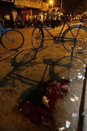 Gallery Mumbai terror attacks: A pool of blood is seen at the site of an attack in Colaba marketin Mumbai
