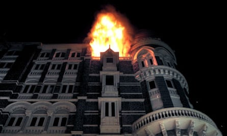 Fire engulfs the top floor of the Taj Mahal hotel, site of a shootout with terrorists in Mumbai