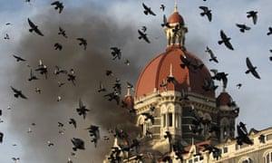 The Taj Mahal Hotel in Mumbai on fire after terror attacks