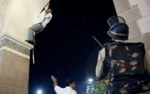 Gallery Terror attacks in Mumbai: A man uses hotel curtains to climb from the Taj Mahal hotel