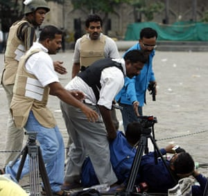 Gallery mumbai update: Members of an anti-terror squad try to remove a reporter