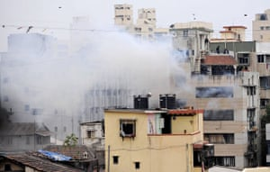Gallery mumbai update: Smoke billows from a building after an explosion