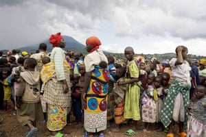 Gallery Congo conflict: A queue of people wait for food at a displaced people's camp in Kibati