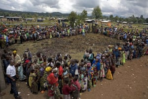 Gallery Congo conflict: Refugees wait for food in Congo