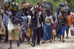 Gallery Congo conflict: People flee Kiwanja near Rutshuru where rebel soldiers were fighting