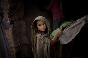 Gallery November 7 2008: A girl waits to buy bread next to the Katcha Garhi camp