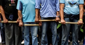 Gallery November 7 2008: Asuncion, Paraguay: Farmers hold sticks during a protest