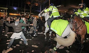 Protestors clash with mounted riot police outside the Israeli embassy in London