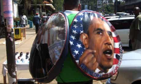 A man sells tyre covers carrying the portrait of Barack Obama in Kisumu, Kenya