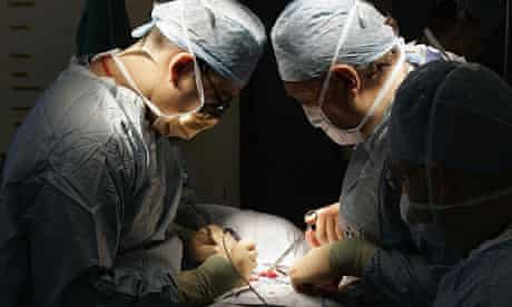 Doctors conduct surgery in a hospital