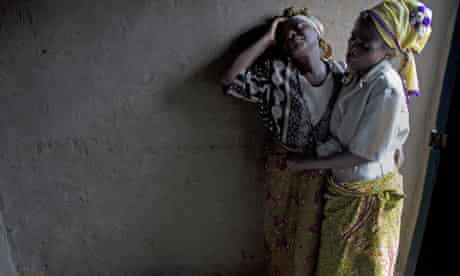 A mother mourns the death of her son, shot when rebels entered the village of Kiwanja, north of Goma