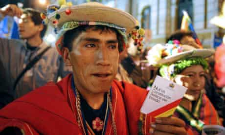 An Aymara native shows the new Constitution in La Paz, Bolivia