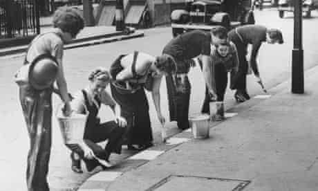 Women painting curbs for the war effort