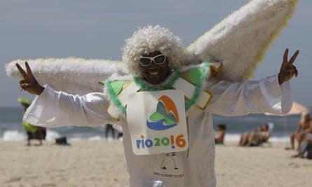A man dressed as an angel  at the Copacabana beach in Rio de Janeiro