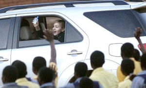 U.S. pop star Madonna waves as she leaves the Home of Hope centre in Mchinji