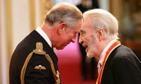Sir Christopher Lee receives his knighthood from the Prince of Wales at Buckingham Palace