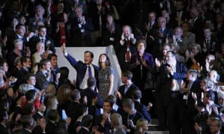 David Cameron, waves as he stands among delegates at the Conservative Party conference