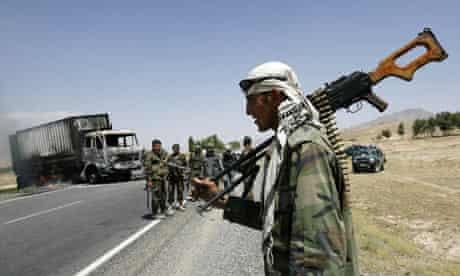 Afghan soldiers at the scene of a Taliban attack on a US supply truck