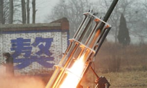 A Chinese rocket fires a cloud-seeding missile into the sky, 2009