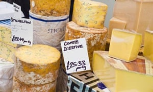 A selection of cheese for sale on specialist stall