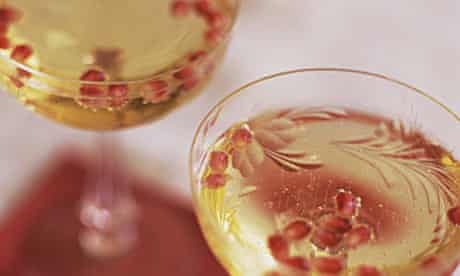Champagne with pomegranate seeds