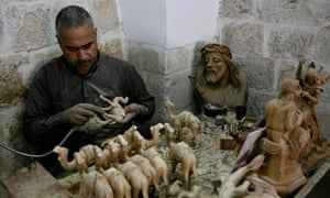 A Palestinian worker at the Giacaman Olive Wood factory in Bethlehem