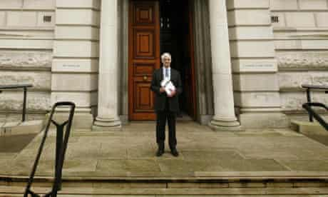 Alistair Darling holds a copy of his pre-budget report