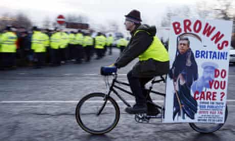 A protestor cycles past the Staythorpe Power Station, Nottinghamshire