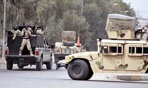 An Iraqi military vehicle carrying jailed journalist Muntazer al-Zaidi