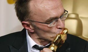 British director Danny Boyle kisses his best director Oscar