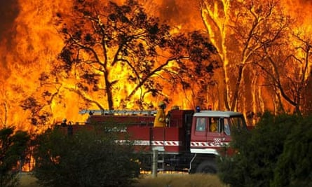 A fire truck in front a bushfire at the Bunyip Sate Forest