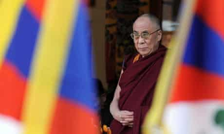 The Dalai Lama offers prayers during a gathering at his palace temple in Dharamshala