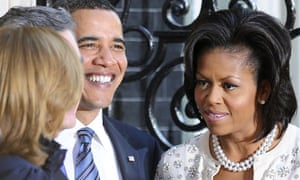 Gordon Brown and his wife Sarah greet Barack and Michelle Obama at Downing Street in London