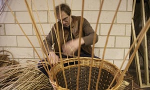 Jonathan Coate at work making a willow basket at P. H. Coate & Son