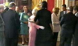 Michelle Obama with her arm around the Queen during a reception at Buckingham Palace
