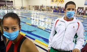 Swine flu Mexican athletes wear masks