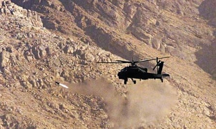 A US Apache helicopter fires a missile during training in Afghanistan
