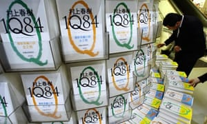 A shopper looks at Haruki Murakami's new book '1Q84' at a bookstore in Tokyo