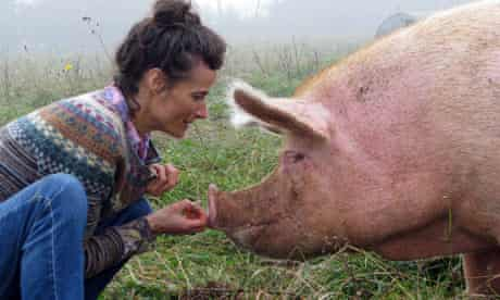 Tracey with a pig