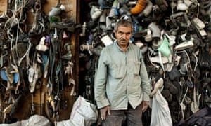 Mahmoud Mohammed Imad in front of his curtain made of garbage in Jabaliya Refugee Camp