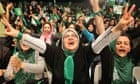 Supporters of Iranian presidential candidate Mir Hossein Mousavi shout slogans