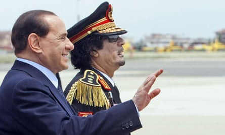 Moammar Gadhafi is greeted by Silvio Berlusconi upon his arrival at Rome's Ciampino military airport