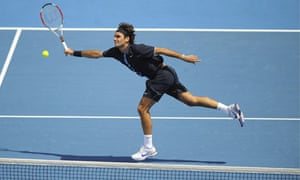 Roger Federer plays a volley