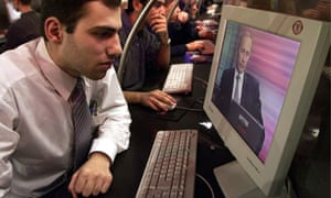 An Internet surfer watches an online interview of Vladimir Putin at an Internet cafe in Moscow